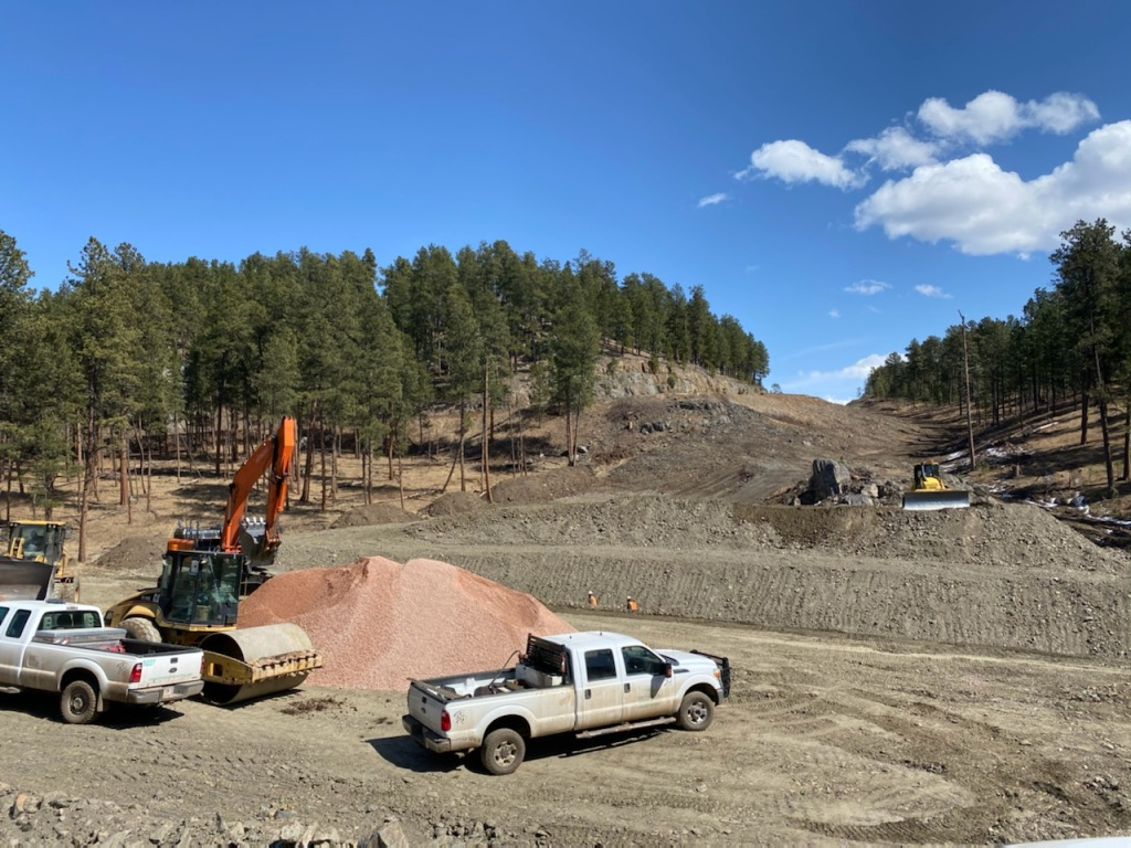 Preparing for installation of 9' x 8' box culvert under the new road alignment for Sheridan Lake Road in Pennington County, South Dakota, Monday March 29, 2021