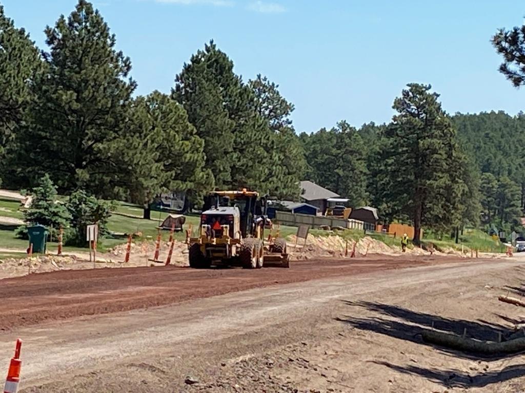 Gravel Placement on Sheridan Lake Road Near Stirrup Court in Pennington County, South Dakota, Monday, June 14, 2021.