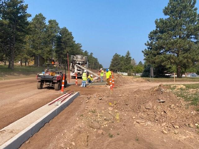 Approach, Curb, and Gutter Work on Sheridan Lake Road, Pennington County, South Dakota, Monday, July 26, 2021.